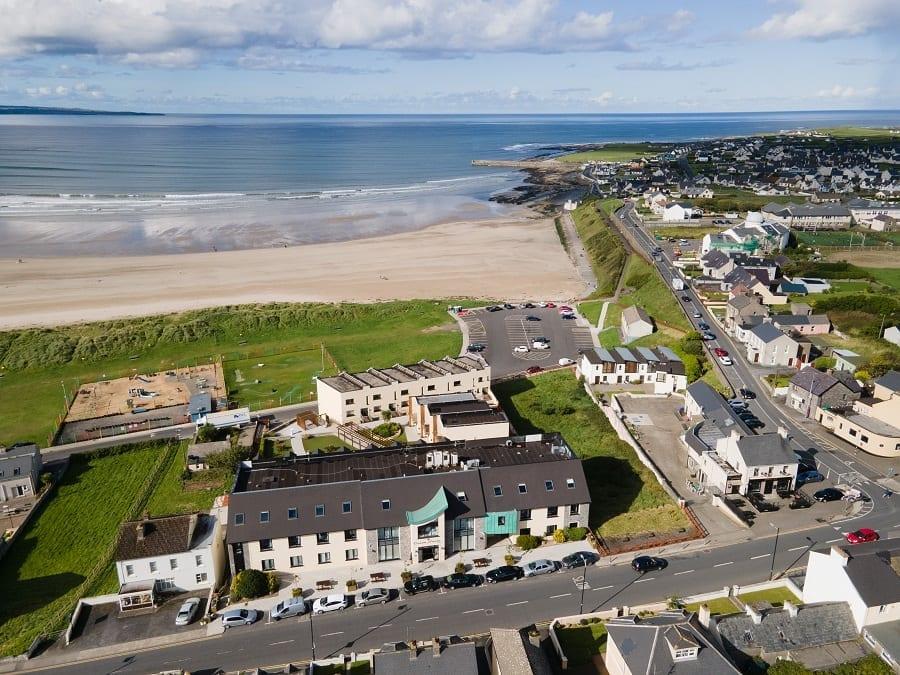 A ocean-sands-hotel-aerial-shot-to-right-of-hotel-golden-beach-in-background-wild-atlantic-way-sligo
