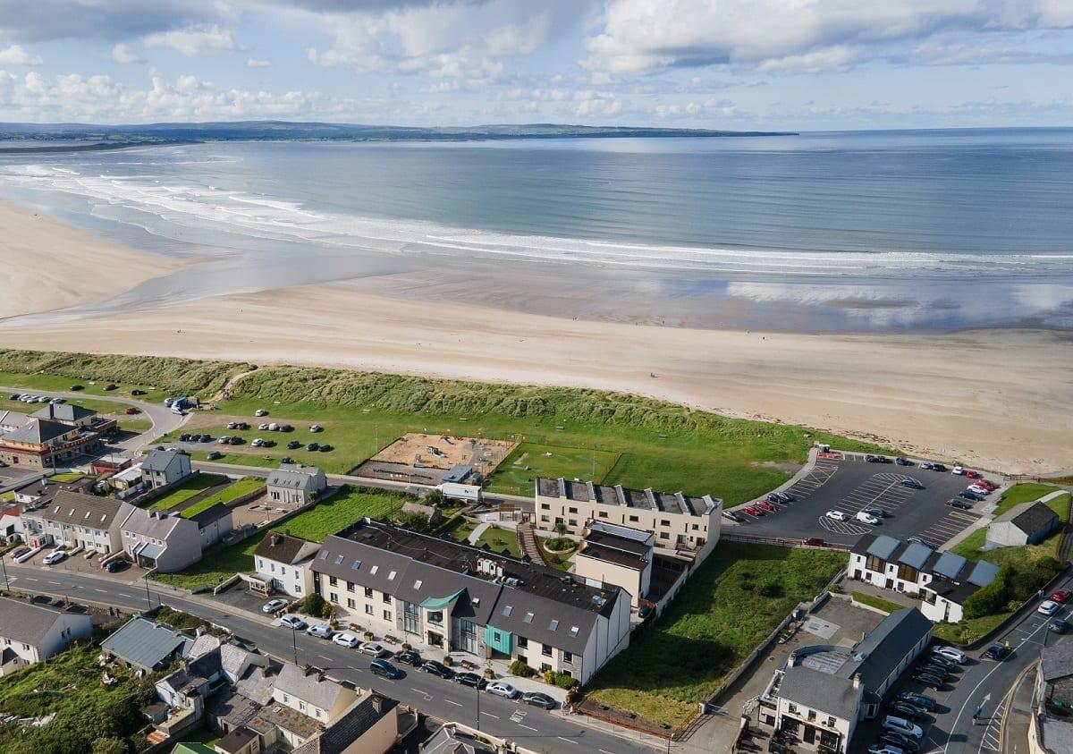 A ocean-sands-hotel-aerial-view-beach-shot-golden-strand-cover-photo