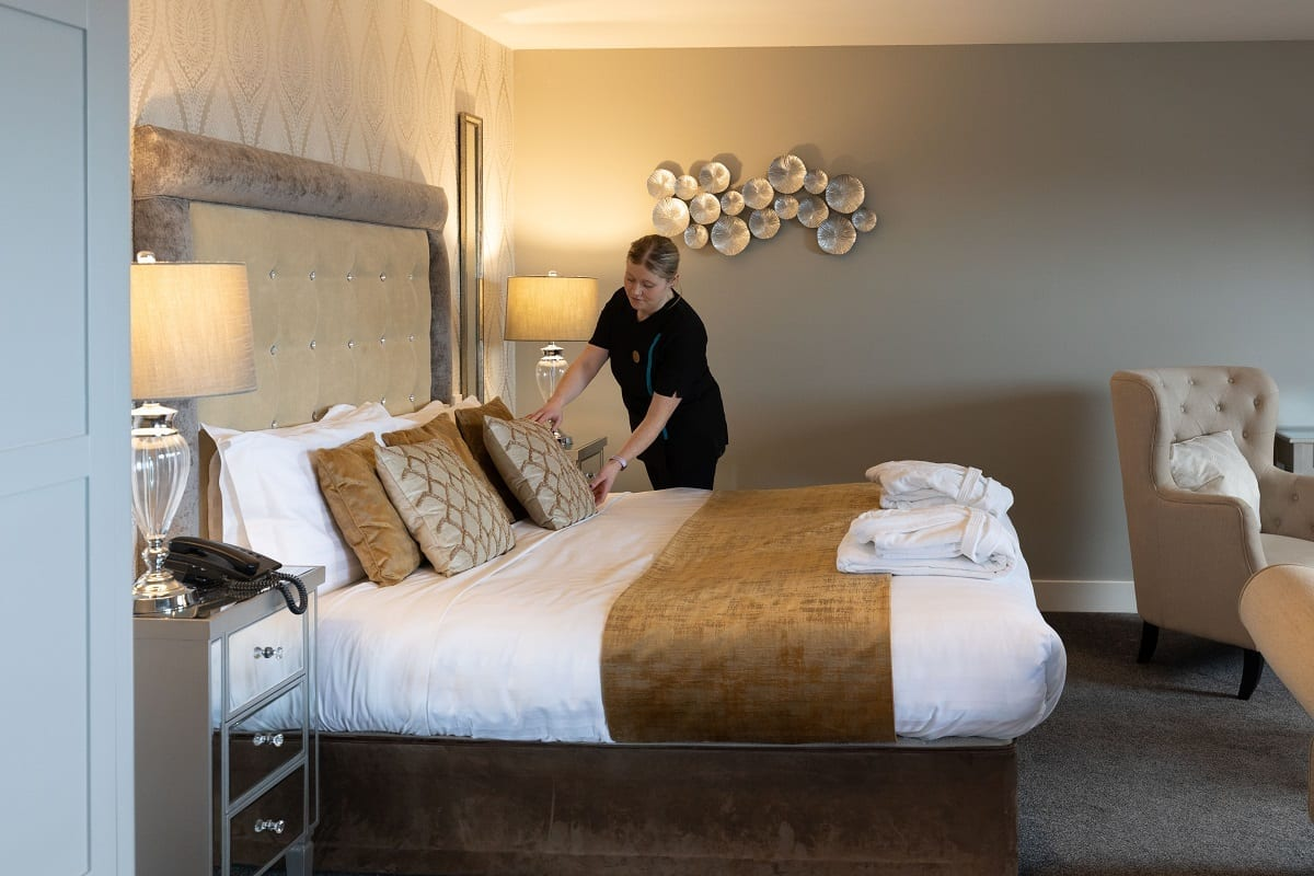A ocean-sands-hotel-bridal-presidential-suite-master-room-emma-fixing-cushions