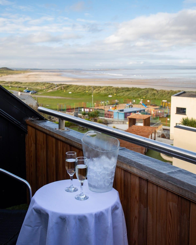ocean-sands-hotel-bridal-suite-balcony-view-to-left-cham[agne-bucket-sligo-couples-escape