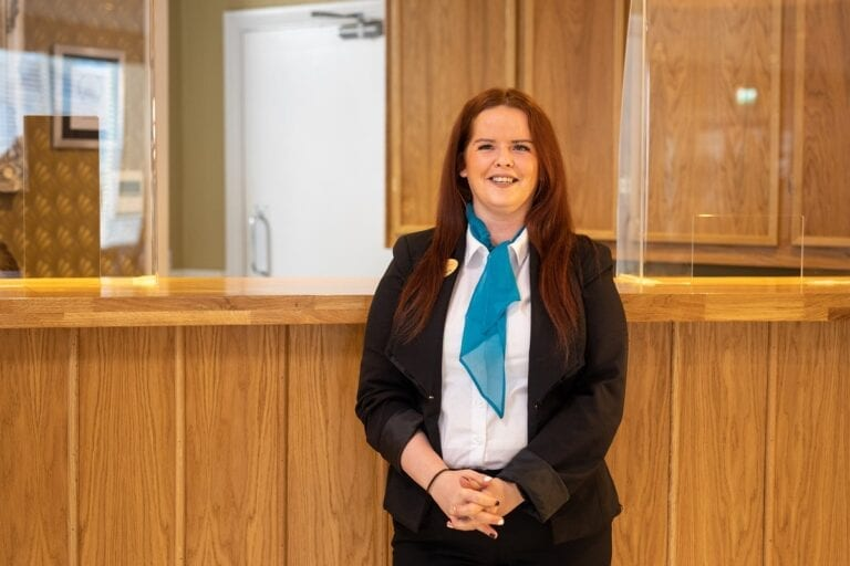 ocean-sands-hotel-staff-anne-marie-in-front-of-reception